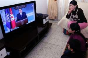 A Tunisian family watches TV on January 13, 2011 as Zine El-Abidine Ben Ali resigns as president.  By Fethi Belaid (AFP/File)