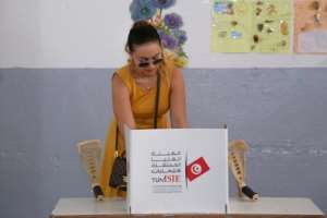A Tunisian voter casts her ballot for presidential election at a polling station in Sousse, south of the capital Tunis, on Sunday.  By ANIS MILI (AFP)