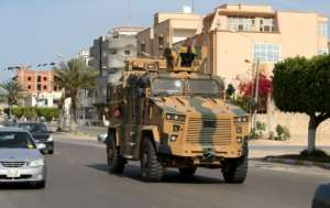 A Turkish-made armoured personnel vehicle drives through the Libyan coastal city of Sorman Monday after the unity government seized it from troops backing military commander Khalifa Haftar.  By Mahmud TURKIA (AFP)