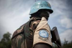 A Tanzanian soldier from the UN peacekeeping mission in the Central African Republic patrols the town of Gamboula on July 6.  By FLORENT VERGNES (AFP)