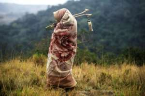 A teenage boy takes a walk in the bush during the traditional Xhosa initiation into manhood. Circumcision is a key part of the ritual..  By MUJAHID SAFODIEN (AFP/File)