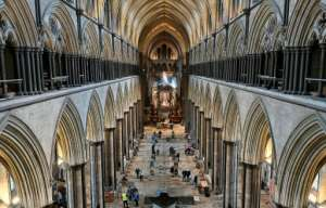 A temporary vaccination centre has been set up inside Salisbury Cathedral in southwest England, with musicians playing the 19th-century organ to soothe the nerves of those waiting for their shots.  By JUSTIN TALLIS (AFP)