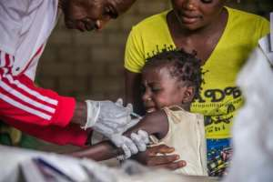 A toddler gets a measles vaccination in western DR Congo last month but further north in Chad the vaccination programme has been hit by the COVID-19 pandemic.  By JUNIOR KANNAH (AFP)