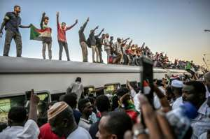 A train laden with demonstrators from Atbara rolled into Khartoum on Tuesday. By OZAN KOSE (AFP)