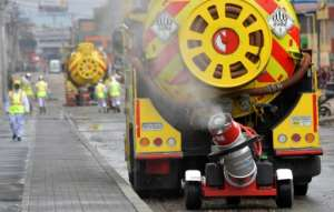 A truck disinfects the streets, as a preventive measure against the spread of the novel coronavirus, COVID-19, in Bogota, Colombia.  By Raul ARBOLEDA (AFP)