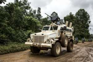 A UN truck patrolling the road linking Beni to Mangina.  By John WESSELS (AFP/File)