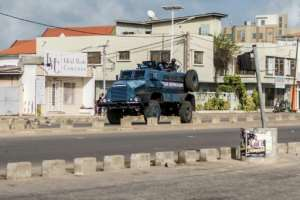A witness said three people were killed when soldiers opened fire to disperse crowds protesting against elections that were held without an opposition candidate.  By Yanick Folly (AFP)