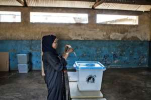 A woman casts her ballot in early voting on Zanzibar where oppoosition leader Seif Sharif Hamad has been arrested a day before Tanzania's election.  By MARCO LONGARI (AFP)
