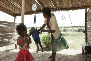 A woman checks the weight of her baby at the health center of the village of Imongy, in southern Madagascar in March 2015