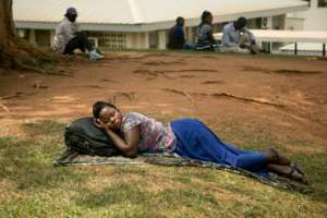 A woman rests as she waits for treatment at Mulago hospital, a hub for treating cancer patients across east Africa