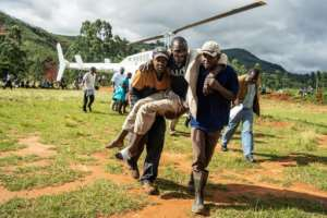 A wounded survivor is evacuated by helicopter from Chimanimani in eastern Zimbabwe.  By ZINYANGE AUNTONY (AFP)