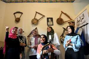 A year ago, Iman Haddo (C), started the Arab world's first all-female semsemia choir called Amwag (waves)..  By Khaled DESOUKI (AFP)