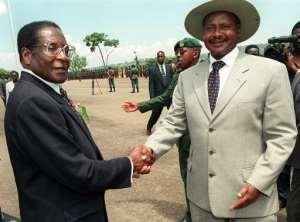 A younger Robert Mugabe with Uganda's President Yoweri Museveni.  By ALESSANDRO ABBONIZIO (AFP/File)