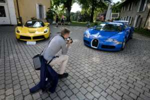 A 2015 Ferrari LaFerrari and a 2010 Bugatti Veyron EB 16.4 Coupe which belonged to Obiang before being seized.  By FABRICE COFFRINI (AFP/File)