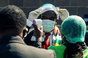 'Act in the national interest', Emmerson Mnangagwa tells health workers.  By Jekesai NJIKIZANA (AFP)