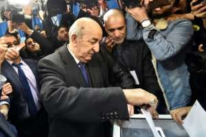 Abdelmadjid Tebboune, seen here voting in Thursday's election, has sought to distance himself from his years of service under Bouteflika.  By RYAD KRAMDI (AFP)