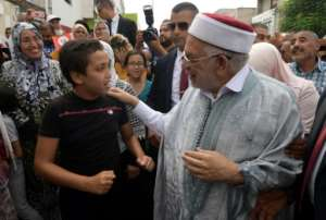 Abdelfattah Mourou of the Islamist-inspired Ennahdha party campaigns in the poverty-stricken Tunis suburb of Ettadhamen ahead of Sunday's presidential poll.  By FETHI BELAID (AFP)
