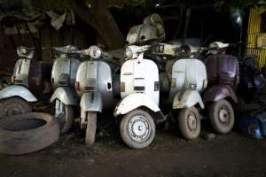 Ageing beauties: Several hundred classic Vespas, most of them made in the 1970s, still cruise the streets of Bamako.  By MICHELE CATTANI (AFP)
