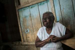 Agida Lucia, 89, says the plantation, or roca, was once grand with a big house, hospital and cinema, and lots of activity. But now it's all closed down.  By Alexis HUGUET (AFP)