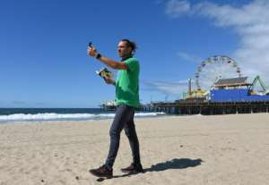 Adam Duford, owner of Surf City Tours, carries out virtual tours via his Instagram feed.  By Robyn Beck (AFP)