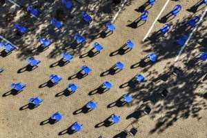 Aerial view of chairs arranged in order to maintain social distancing at a parking lot in Soweto for food distribution.  By MARCO LONGARI (AFP)