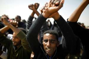African migrants protest outside the Saharonim Prison on February 22, 2018, after announcing a hunger strike over Israel's policy of prison or deportation for migrants