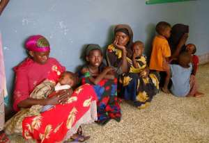 Somali women hold their malnourished children as they wait to admit them at the Mogadishu Banadir hospital.  By Mustafa Abdi (AFP/File)