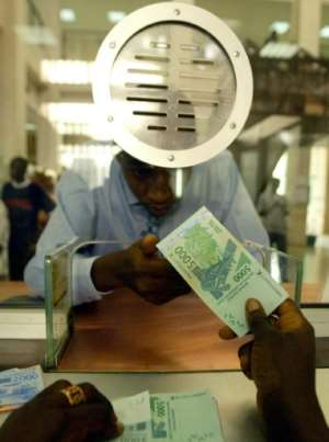 Africa's financial interests would be better served by severing the fixed euro link and depositing reserves in Africa instead of France as currently, say the proponents of reform.  By SEYLLOU DIALLO (AFP/File)