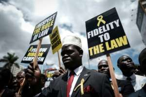 After opposition activist Miguna Miguna was forcibly deported, Kenyan lawyers demonstrated in Nairobi on February 15 against state disobedience of court orders.  By Yasuyoshi CHIBA (AFP/File)