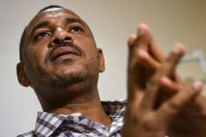 Ahmed al-Rabia, one of the Sudanese anti-government protest leaders.  By OZAN KOSE (AFP)