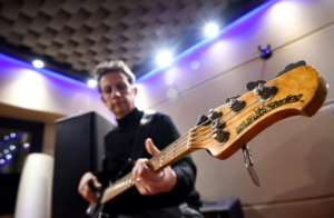 Ahmed Hafez, bassist for Egyptian rock band Massar Egbari, warms up in a recording studio in Cairo. By Mohamed el-Shahed (AFP)