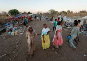 Ahead of Christmas, food prices soared in the Um Raquba refugee camp, packed with some of the nearly 60,000 Ethiopians who have crossed into Sudan.  By ASHRAF SHAZLY (AFP)