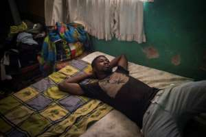 Albert Oppong, 30, who graduated but has not found a qualified job for the past five years, says he's sceptical of talk of a brighter future in Ghana.  By CRISTINA ALDEHUELA (AFP)