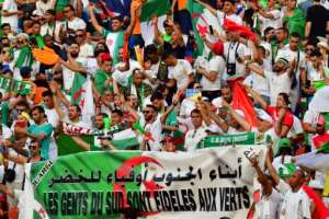 Algeria supporters cheer ahead of the 2019 Africa Cup of Nations (CAN) final football match between Senegal and Algeria at the Cairo International Stadium on July 19, 2019.  By Giuseppe CACACE (AFP)