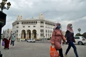 Algerian women walk past the main post office in Algiers on August 12, 2020. One well-known TV presenter has criticised a culture of street harassment against women in the North African country.  By RYAD KRAMDI (AFP/File)