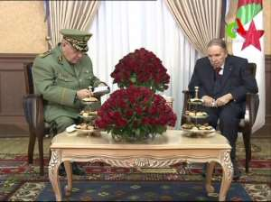 Algerian army chief Ahmed Gaid Salah (L) has emerged as a key powerbroker since Abdelaziz Bouteflika, seen in this March picture, resigned in April in the face of massive street protests.  By - (CANAL ALGERIE/AFP)