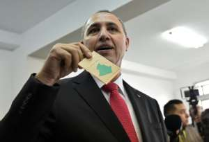 Algerian former culture minister Azzedine Mihoubi casts his vote.  By RYAD KRAMDI (AFP)