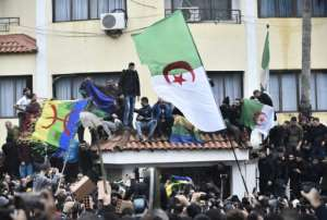 Algerian protesters have flown the Berber flag at demonstrations against presidential elections, despite a ban on symbols 'undermining national unity'.  By RYAD KRAMDI (AFP)