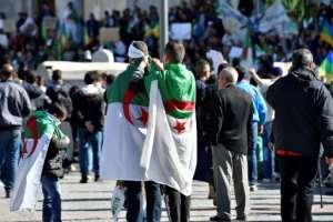 Algerian protesters want President Abdelaziz Bouteflika to step down. By RYAD KRAMDI (AFP)