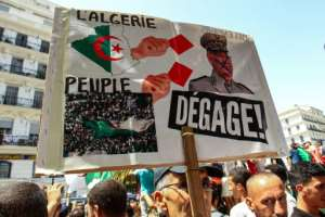 Algerian protesters who once praised Gaid Salah for his intervention to force Bouteflika's resignation now despise the general.  By - (AFP/File)