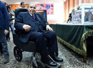 Algerian President Abdelaziz Bouteflika votes in legislative elections at a polling station in Algiers in May last year.  By RYAD KRAMDI (AFP/File)