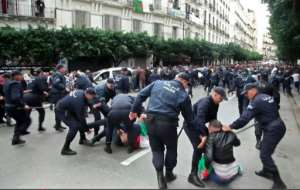 Algerian security forces detain polling day protesters in the capital Algiers.  By Yacine BENRABIA (AFP)