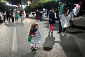 Algerians celebrate Bouteflika's resignation on April 2 last year.  By RYAD KRAMDI (AFP/File)