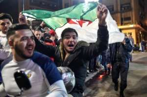 Algerians celebrated on the streets after Bouteflika announced he would not seek a fifth term in office. By RYAD KRAMDI (AFP/File)