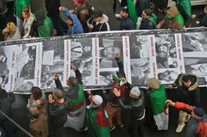 Algerians have been holding weekly Friday protests since February demanding an overhaul of a political system that has been in place since independence from France in 1962.  By RYAD KRAMDI (AFP)