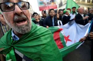 Algerians protest Friday against a presidential election set for next week that they see as an attempt by the elite to shore up its authority.  By RYAD KRAMDI (AFP)