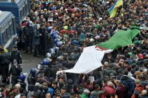 Algerians rally in the capital Algiers on February 22, 2021, marking the second anniversary of the country's Hirak anti-government protest movement.  By RYAD KRAMDI (AFP)