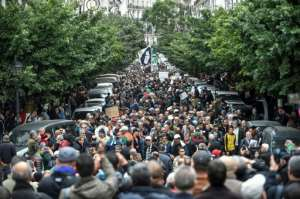 Algeria's powerful army chief General Ahmed Gaid Salah -- who died Monday -- asked president Abdelaziz Bouteflika to resign in April in the fact of an unprecedented protest movement.  By RYAD KRAMDI (AFP)