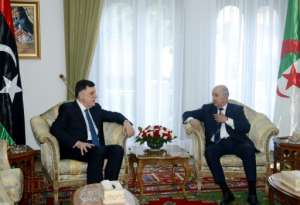 Algeria's President Abdelaziz Tebboune (R) holds talks with Libya's UN-recognised Prime Minister Fayez al-Sarraj as concerns mount of an escalation in Libya.  By - (APS/AFP)