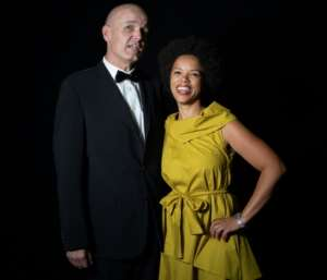 Alicia Thompson (R) -- pictured with club member John Clark -- is seeking to reposition the club, attracting the city's young executives.  By MARCO LONGARI (AFP)